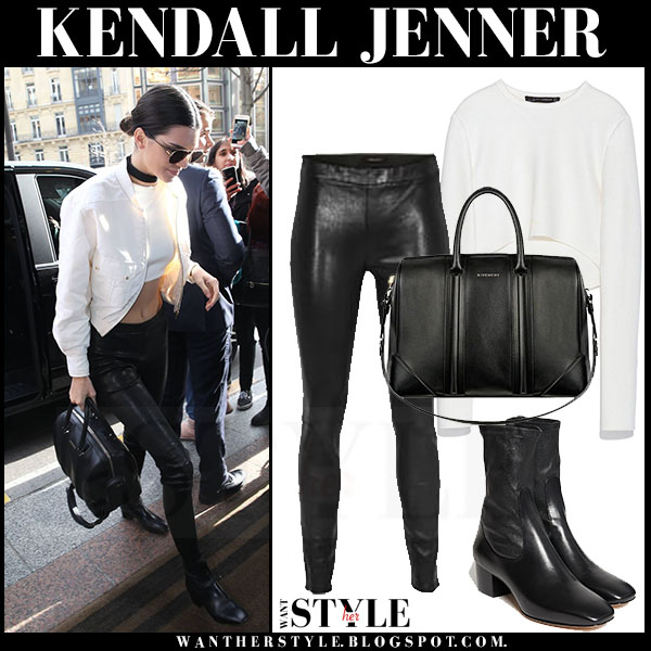 Kendall Jenner in white bomber chanel jacket with black leather j brand pants and ankle sandro amele boots what she wore