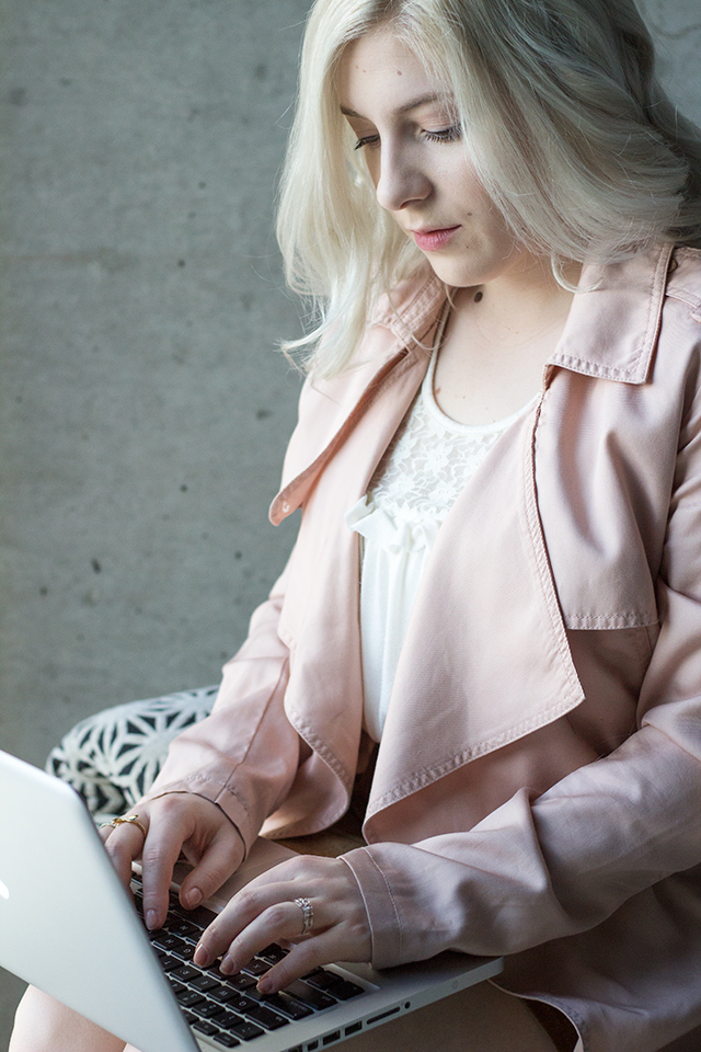 Blush trench coat with a lace tank top.