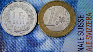 Imagem moeda franco suiço e euro