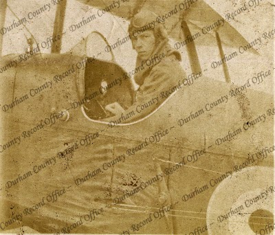 Photograph of a Royal Flying Corps officer seated in the cockpit of a biplane, n.d. [1917] (D/DLI 7/880/1(61))