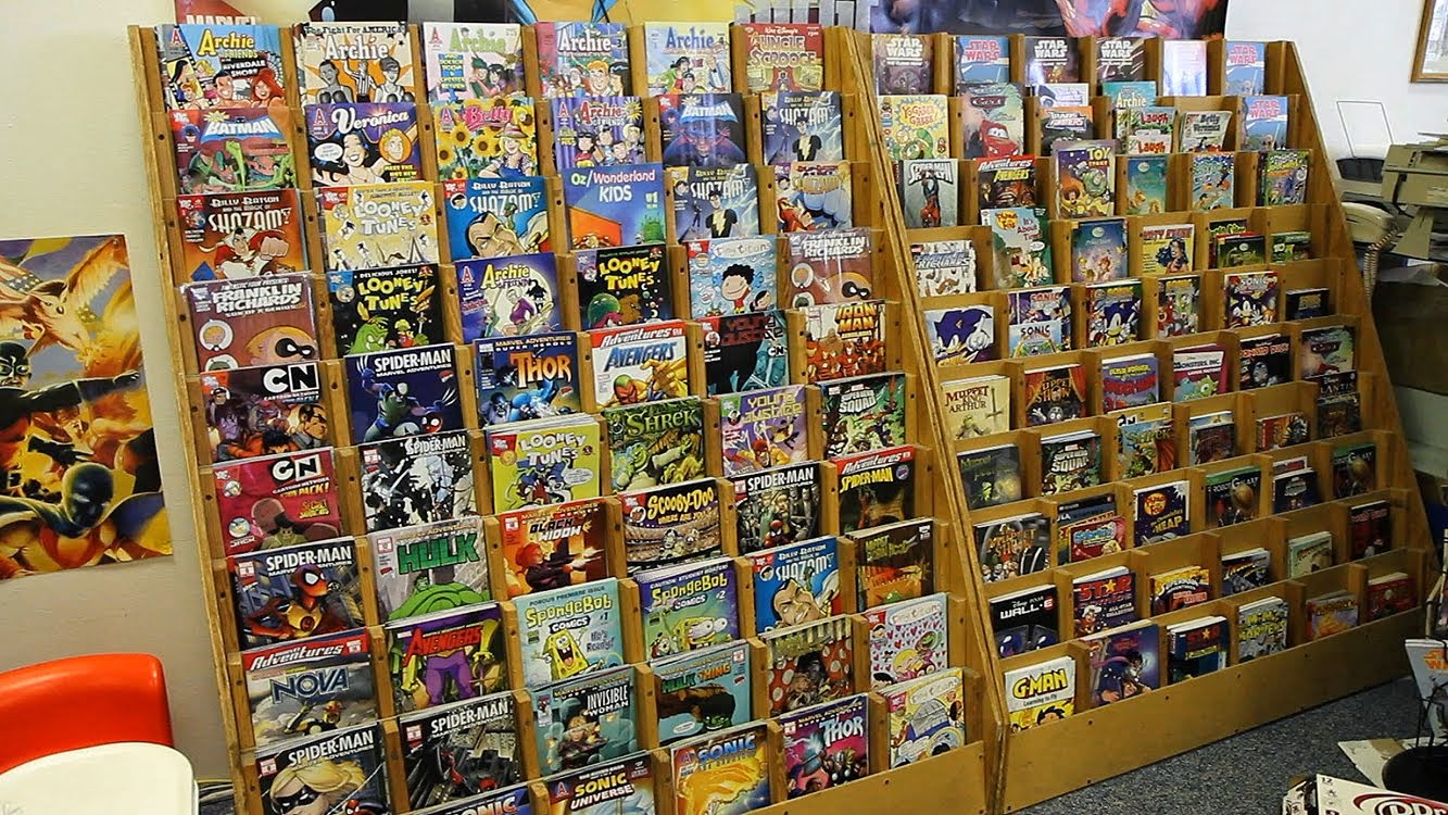 Joe torcivia 39 s the issue at hand blog bat backsliding and some other titles too - Comic book display shelves ...