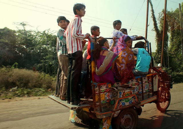 Passengers on a Chagda or rickshaw in Gujarat