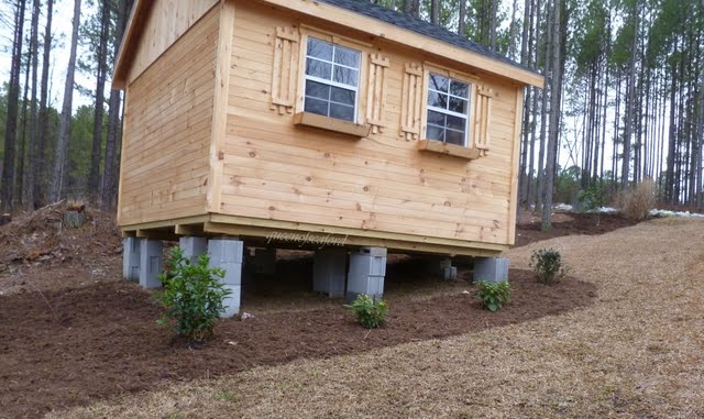 how to build a storage shed on a slope