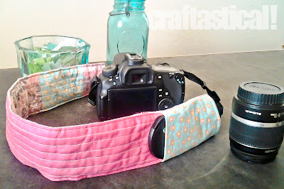 Pink and aqua quilted digital SLR camera strap cover