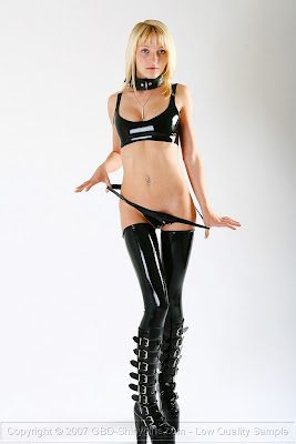 Shinygirl Justine in Latex Stockings and Boots
