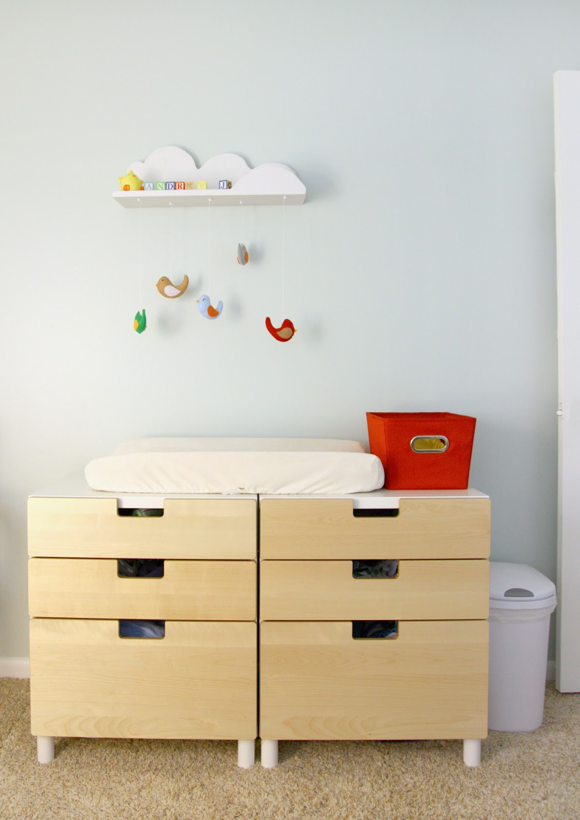 A baby room with stuva changing table and wardrobe in green and ...
