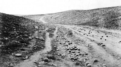 Roger Fenton's iconic 1855 photo of the 'Valley of the Shadow of Death' Crimea with canon balls placed on the road.