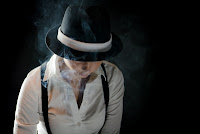 woman in hat with smoke