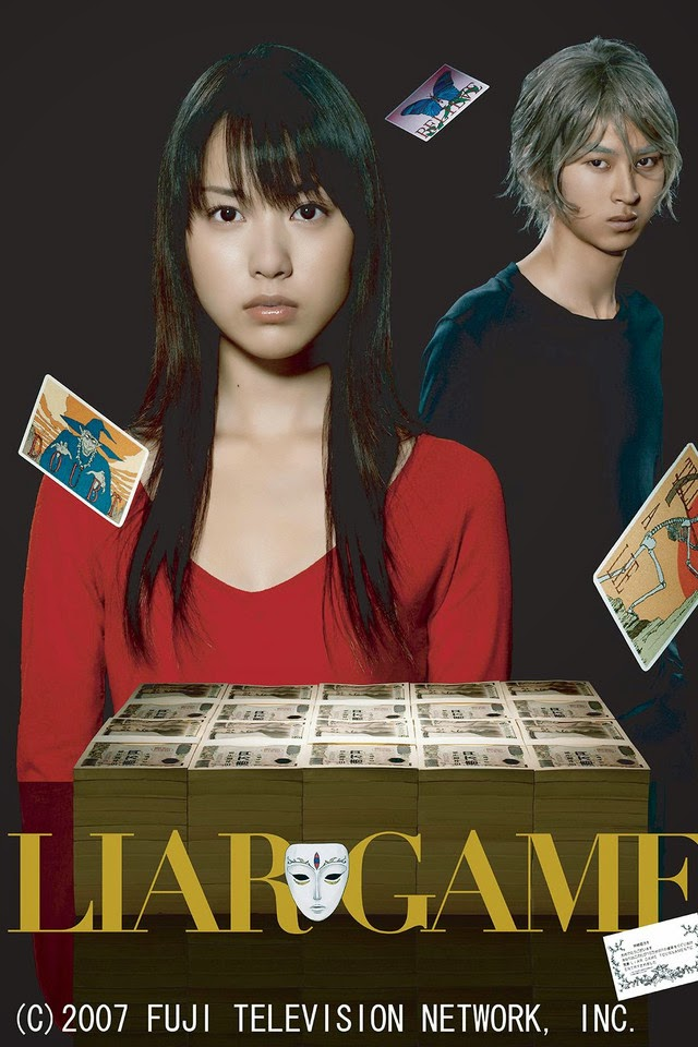 The main characters, Nao and Akiyama, posing with playing cards in the air.