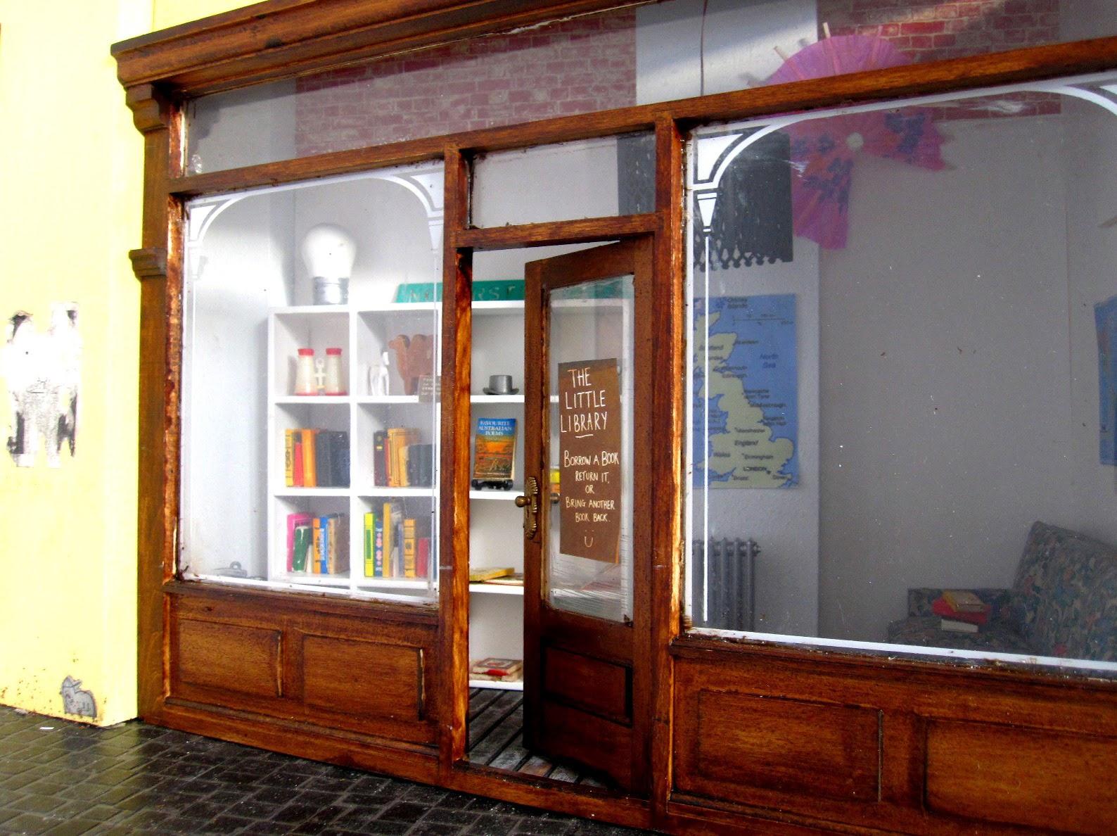 Modern dolls' house miniature pop-up Little Library.