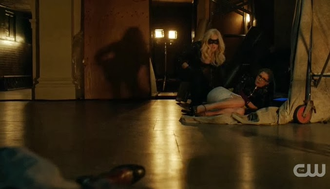 Sara Black Canary Felicity Caity Lotz Emily Bett Rickards shot on the ground saving