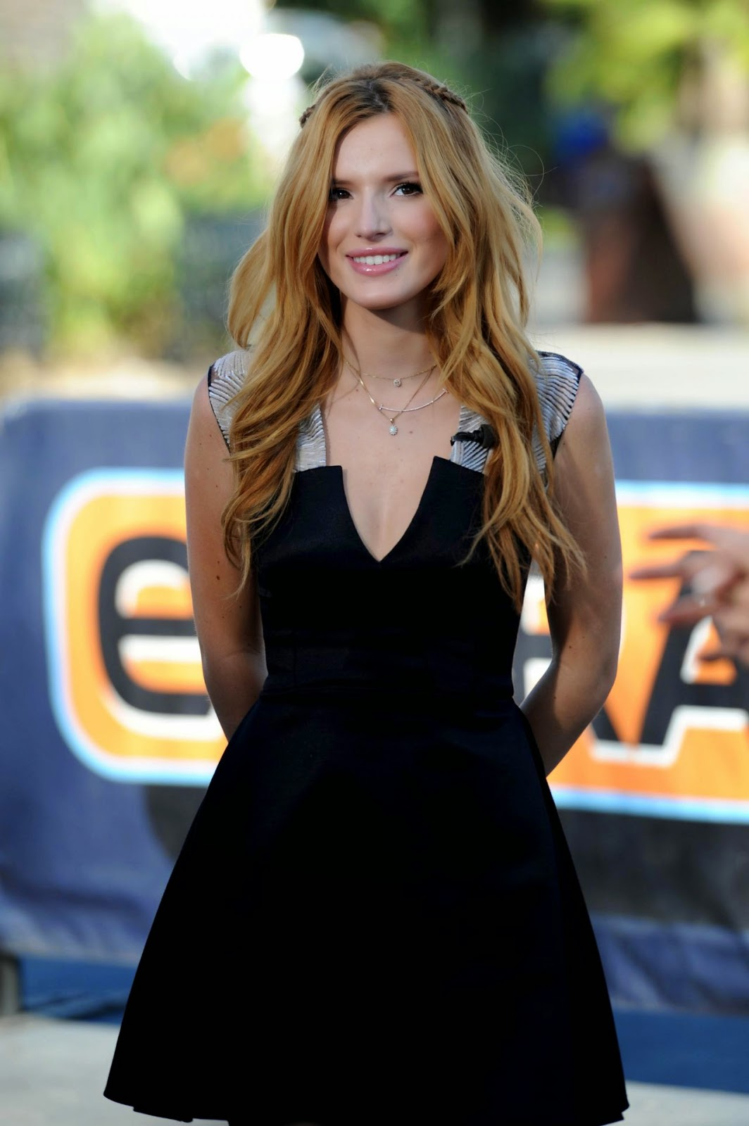 Bella Thorne wears a little black dress to the set of Extra in Universal City