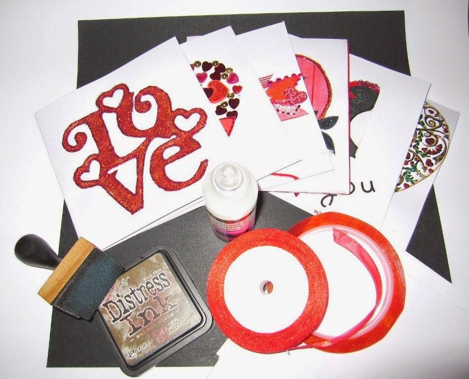material para hacer el LOVE miniálbum de scrapbooking: 6 tarjetas San Valentín, 5 sobres, papel básico negro, cinta adhesiva doble cara, distress ink walnut stain, cinta raso rojo, glossy accents