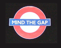 "Famous London underground ""mind the gap"" phrase applied to the underground logo, and printed on a teeshirt"