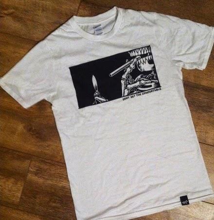 http://daggersforteeth.bigcartel.com/product/dont-get-too-comfortable-tshirt