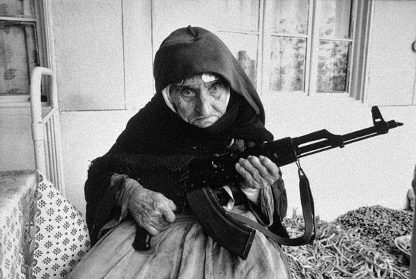 These 15 Incredibly Rare Historical Photos Will Leave You Speechless - 106-year-old Armenian woman guards her home in 1990.