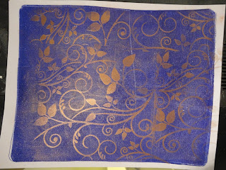 Cobalt blue gelli plate background with extended bronze swirl