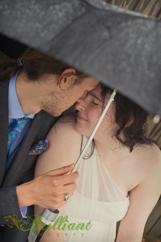 Newlyweds Alyssa and Nick under an umbrella at Long Beach - Patricia Stimac, Seattle Wedding Officiant