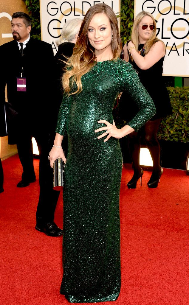 Olivia Wild in a dark green spaklning Gucci dress at the 2014 Golden Globe Awards