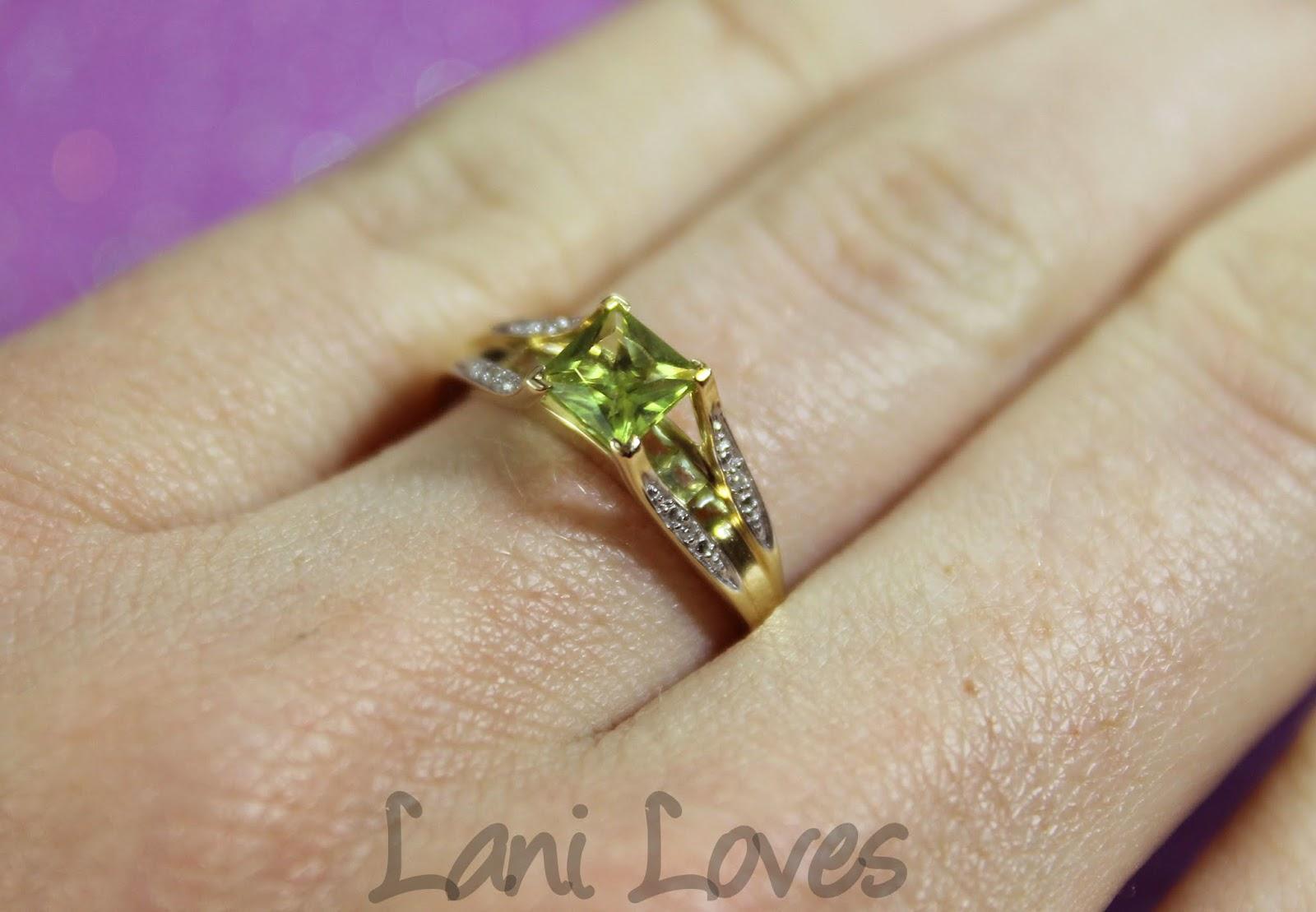 Peridot and diamond engagement ring