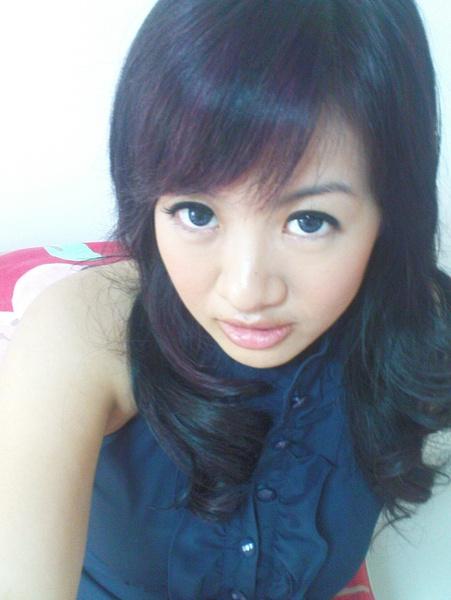 short black hair red highlights. Purplish lack. Hair was