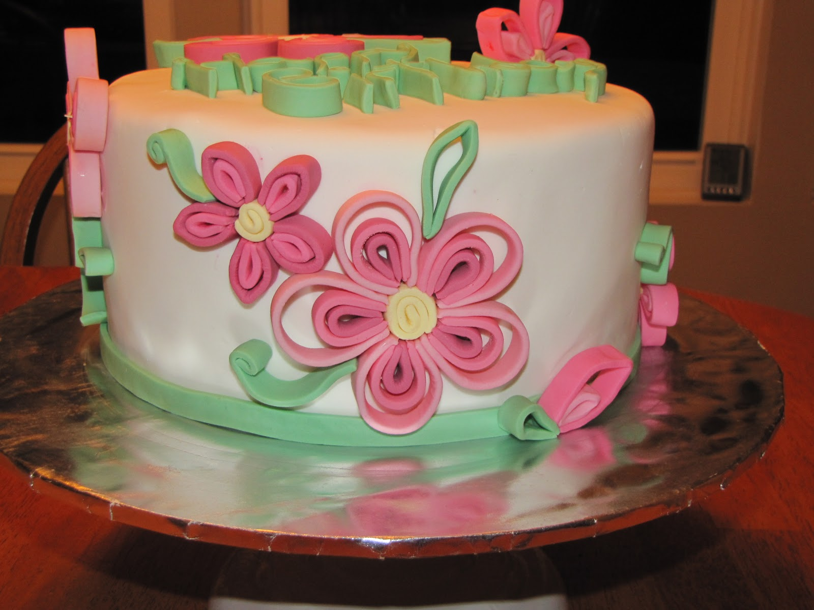 Cake was fun chocolate cake with ganache filling quilled flowers