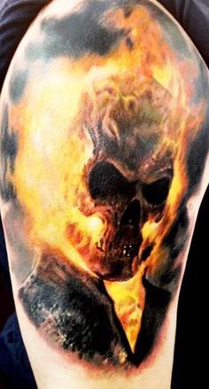 Flaming skull tattoo on arm