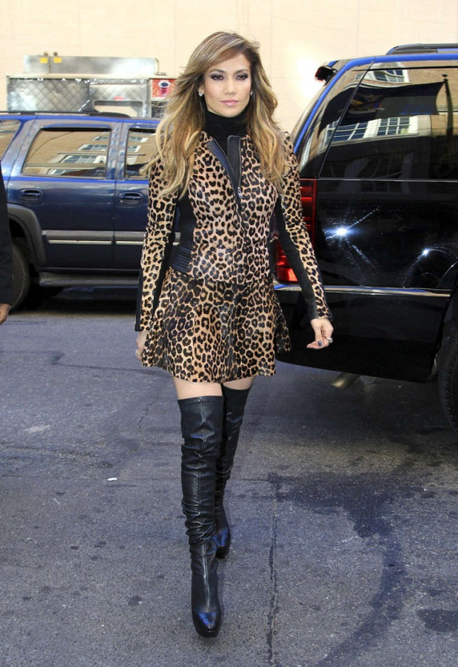 in a leopard print mini dress and thigh