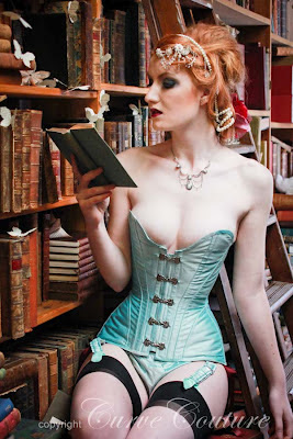 Mint green silk corset with silver clasps