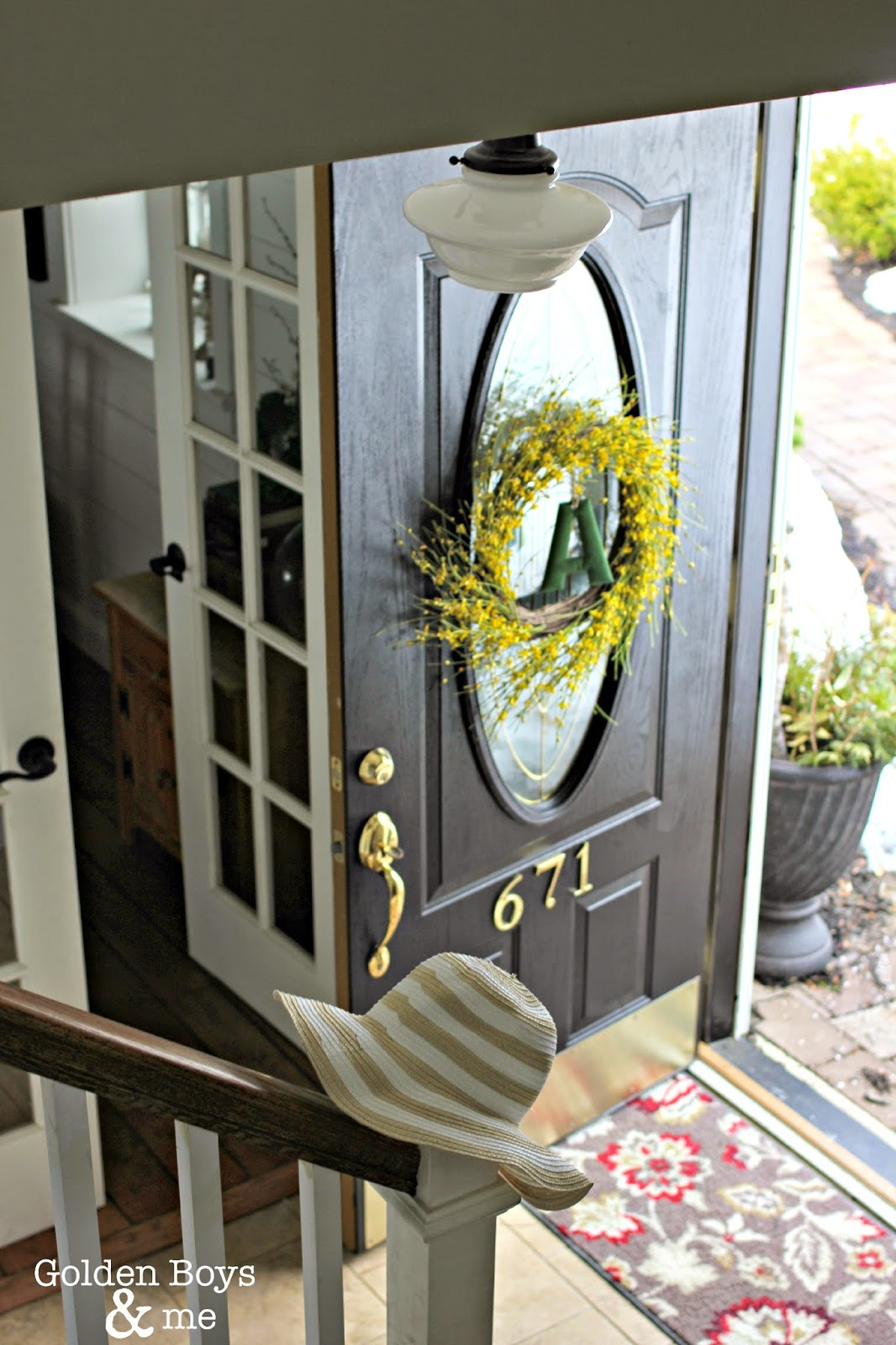 Black front door with spring decor-www.goldenboysandme.com