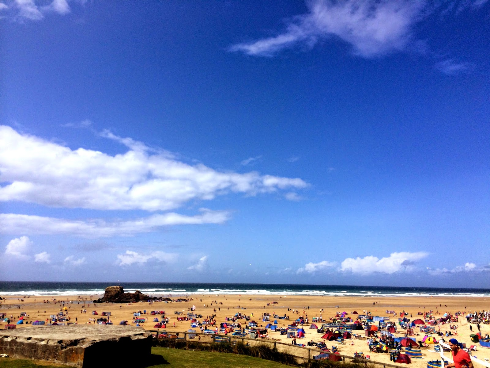 Blue skies and golden sands in Perranporth, Cornwall