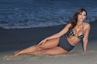 Vivian Kindle posing on a sandy beach