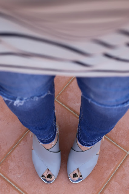 The Fashionable mum in stripes and distressed jeans
