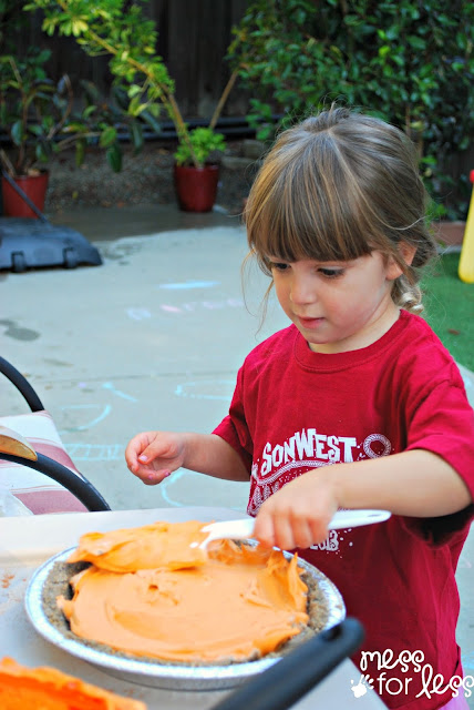 Scented Shaving Cream Pumpkin Pie - This fall sensory activity allows kids to create a play pumpkin pie using sand and shaving cream.