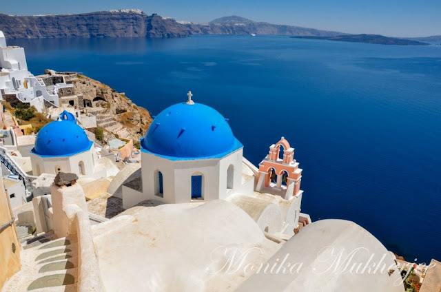 Oia Blue Roof Santorini Greece by Monika Mukherjee