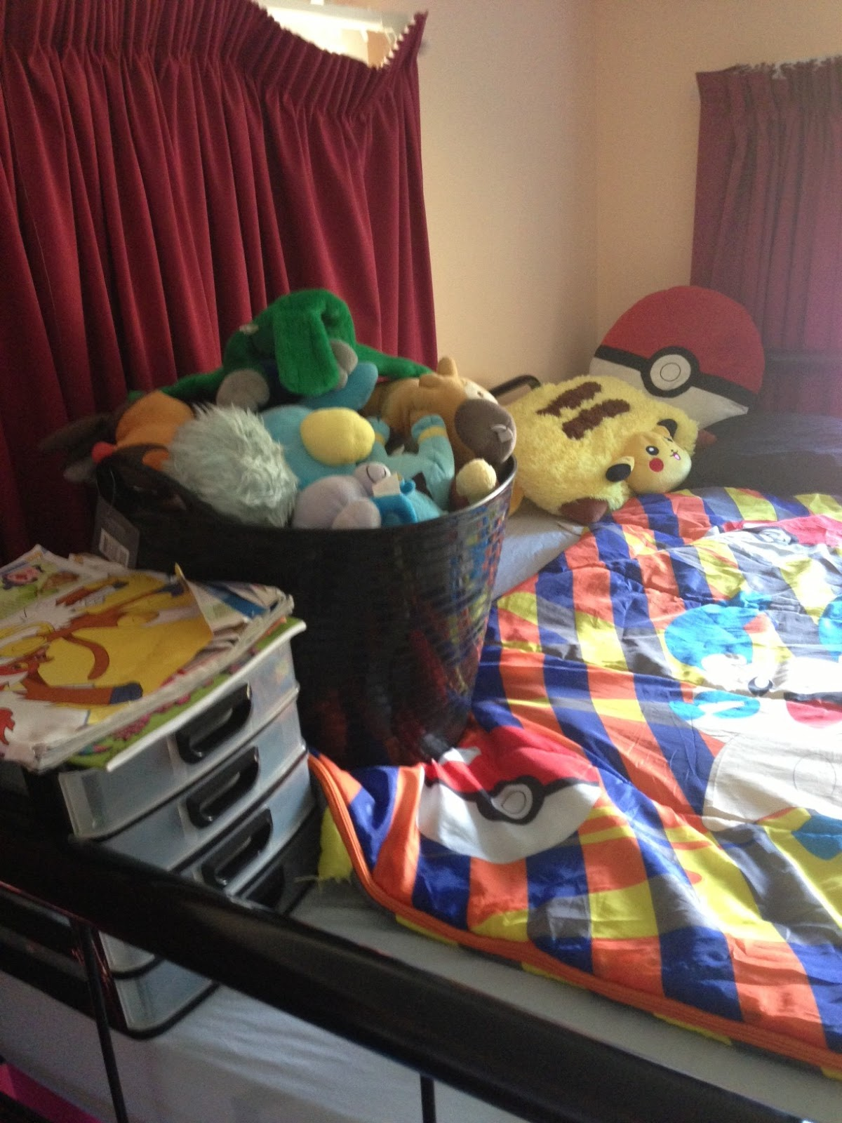 Fabulous  bed plus his entire plush Pokemon collection There is just enough room for him in his Pokemon sleeping bag with his Voltorb pillow thanks to his