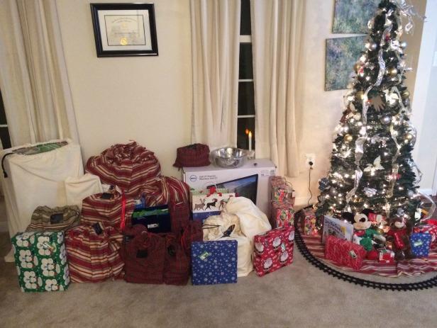Reusable fabric gift bags around the Christmas tree.