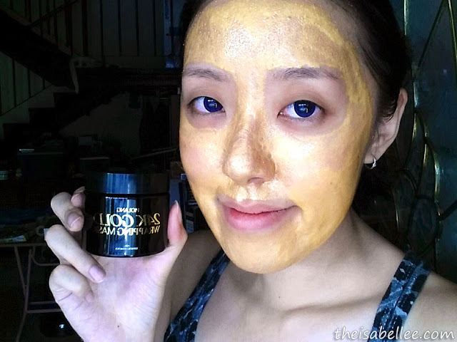 Applying Piolang 24K Gold Wrapping Mask on face