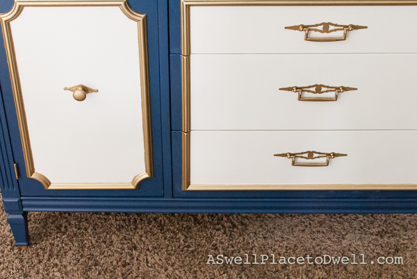 Navy blue, white and gold credenza from www.aswellplacetodwell.com