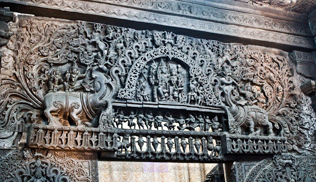 The intricately carved doorjamb of the Garbhagriha