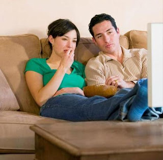 Is Your Man Jealous Of Your Celebrity Crush - man and woman watching tv