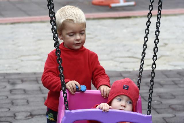 Anton pushing Neve on the swing.