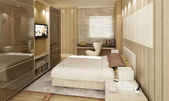 decoracao de apartamentos pequenos quarto casal:É possível a TV ficar entre os armários sem perder
