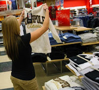 photo of female apparel shopper inside retail store
