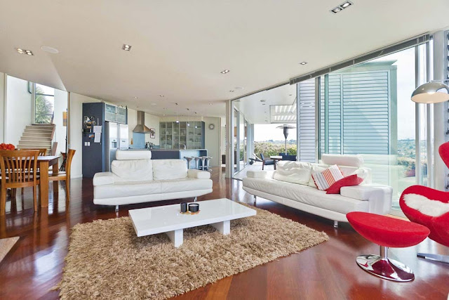 Photo of white and red furniture in the living room during the day