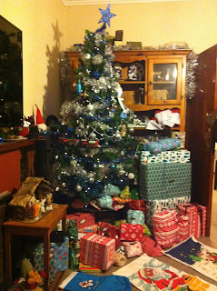 A Christmas tree, surrounded by presents.