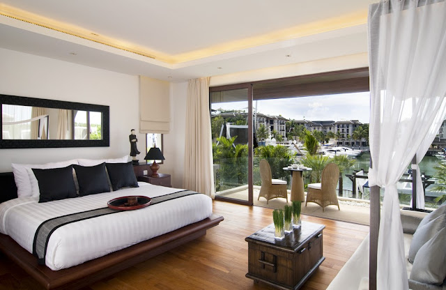 Picture of the modern bedroom looking out on the marina