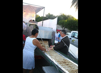 The largest burrito weighed 12,785.576 pounds and was achieved by CANIRAC La Paz