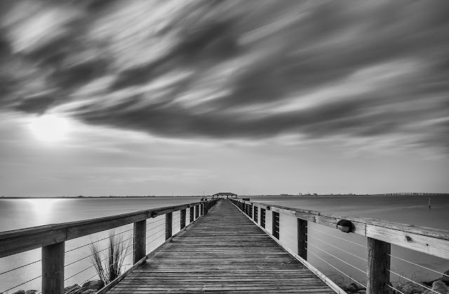 Long exposure of clouds and sunset at Melbourne Beach Pier