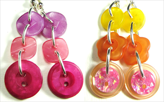 Colorful dangle earrings with fun buttons hanging in long strands